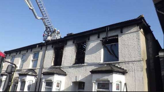 Crews take more than three hours to put out blaze that guts two semi-detached houses in Leyton